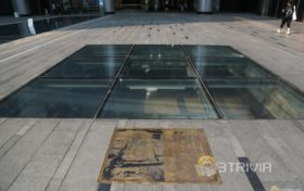 What is hidden under the glass of Chunxi Road subway station?