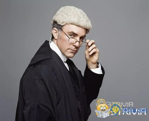 Why do British judges and lawyers wear wigs?